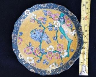 Small plate with bird decoration