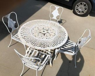 WOODARD IRON CHAIRS WITH BASKET OF FLOWERS, PRISTINE SHAPE , HEAVY ANTIQUE VICTORIAN  CAST IRON TABLE SOLD SEPERATE
