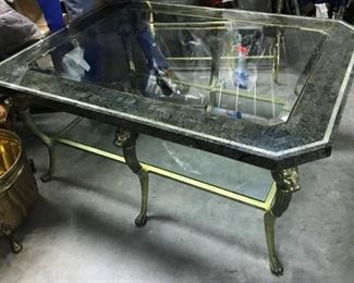 DESIGNER HEAVY BIG COFFEE TABLE WITH BRASS LIONS HEADS, INLAID BEVELED GLASS, WITH GLASS SHELF ALSO.  ONE TIME OFFER OF  $350.00                                                     REALLY A STEEL OF A DEAL FOLKS