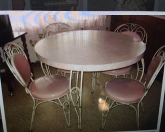PINK FORMICA 1950'S IRON TABLE WITH HEART SHAPE CHAIRS  $ 250.00 SET  THE ITALIAN MID CENTURY IRON CHANDELIER WOULD BE PERFECT TO HANG ABOVE THIS TABLE