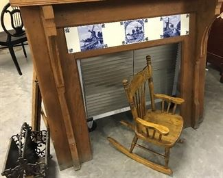 PRIMITIVE PINE FIREPLACEWITH ANTIQUE HOLLAND TILES  $ 250.00,PRESSED BACK CHILDS ROCKER 120.00