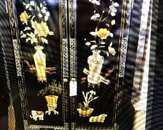 CUSTOM MADE BLACK LACQUER ARMOIRE, MADE FROM A FOLDING SCREEN, WE HAVE THE OTHER TWO PANELS THAT MATCH.  HAND CARVED STONE ACCENTS.       CAN BE USED AS A BAR,  ALSO HOLDS A 42 INCH TV  $  395.00