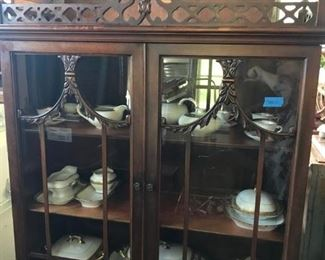 CHIPPENDALE WALNUT ANTIQUE SMALL CHINA CABINET, WITH A DRAWER, ORIGINAL FINISH, BEAUTIFUL CARVING, WOULD BE BEAUTIFUL IN ANY ROOM.  PAUL MULLER WHITE PORCELAIN PIECES INSIDE,WITH GOLD ENCRUSTED EDGES, STUNNING FOR A HOLIDAY TABLE