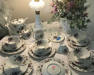 LEFTON CHINA TEA SET SET OF 6 WITH CANDY DISH TOO.            MILK GLASS ANTIQUE LAMP,       ITALIAN LACE BOWL WITH SILK FLOWER ARRANGEMENTS