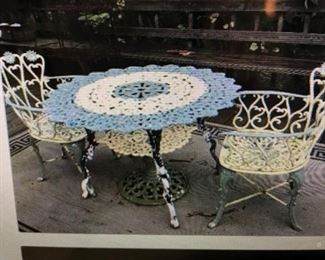 ANTIQUE HEAVY VICTORIAN CAST IRON TABLE, WITH ORIGINAL BABY BLUE PAINT. , COMES WITH 2 , SWEET FANCY FLORAL CHAIRS WITH MATCHING PAINT. RARE FIND