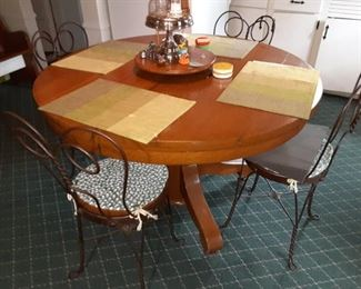 Antique oak dining room table with original wrought iron wire legs and sweetheart back