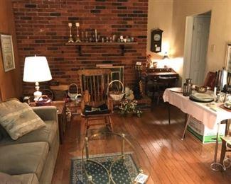 candlesticks, sofa, brass glass top table,