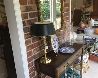 Foyer table with décor, wall mirror