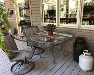 Patio set: Hampton Bay table and 2 swivel chairs...