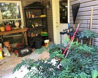 Assortment of hand tools, lawn mower, pots...