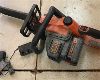 Black & Decker battery operated saw with charger