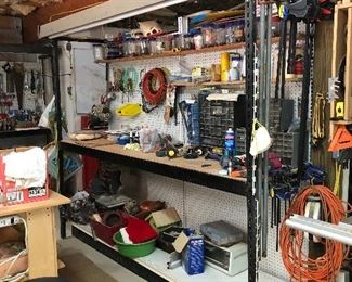 Great Black and Decker work station with pegboard and lights, more craft items and tools
