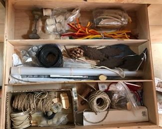 Woodworking and craft assortment: knobs, twine, book of craft ideas/patterns...