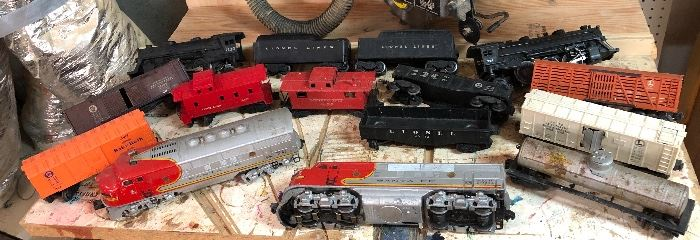 Vintage Lionel train set: Engines, trains, flat cars, tracks, switches, remote control, accessories... Trains/cars: Santa Fe, Baby Ruth, Lionel Lines, Pennsylvania, Automatic Refrigerated milk car, Senoco...