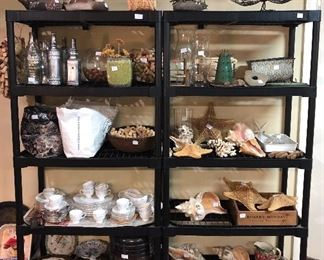 Shelves full with all kinds and sizes of shells, Wedgewood, decorative bottles, pots, wine corks, decorations...