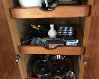 Full of cookware! Pots, pans, cookie sheets, cake pans, muffin pans, chopper, garlic press...
