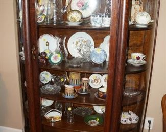 Beautiful display cabinet filled with china, pottery, glass