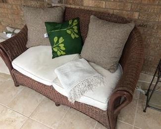 Wicker sofa and matching chair with ottoman