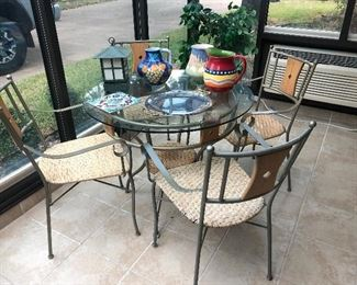 Round glass top table and 4 chairs