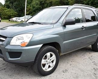 At 8PM: 2009 Kia Sportage LX SUV with 30,632 Miles; Gray-Green Exterior; Black Sport Cloth Interior; Power Windows, Locks, Mirrors; AM/FM Stereo with CD/MP3/Sirius; Automatic Transmission; V6, 2.7L Engine; 2 Wheel Drive. VIN: KNDJF723297636152 Vehicle Terms: - Vehicles are sold AS IS, in AS FOUND/ESTATE condition. - Minimum of 10% deposit due on day of auction (Cash, Check, VISA, MC, or Debit). - Balance paid in full by Thursday following (Cash or Certified Bank Check ONLY).