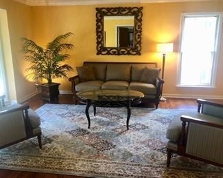 Beautiful Walter E. Smithe Sofa, two Chairs by Martha Stewart for Bernhardt.  Gorgeous Sorento area rug, lovely framed mirror, coffee table, tree and opposite wall some Paris prints.  OOh la la!