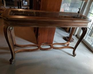 $50 Glass top console table
