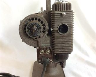 Vintage Revere Eight Model 85 8mm Projector. Lamp and motor are in working order. Note that case is not original.