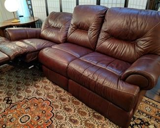 $150  Burgandy Leather power recliner.