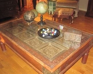 Glass topped Coffee Table with detailed copper plate accents.