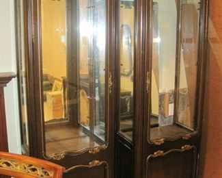 A pair of Display/Curio Cabinets with mirrored backs and lights.