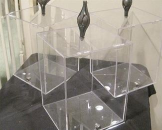 Lockable display cases with finials.