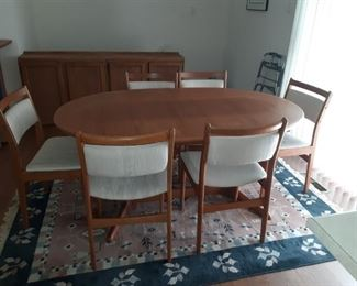 Rasmus teak dining room table with self storing leaves and 6 chairs
