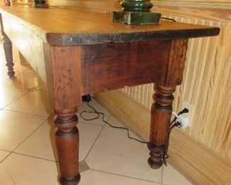 "Offered at $3600.  French scrubbed Pine work table, most likely used for meat grinding, cutting and curing. Beautiful patina with wide board top, scrubbed pine top, and large turned legs. A handsome and unique look with interesting distress and real design presence. c. 1860 (26.5""w x 95.25""l x 31.5""h) ~ Please send inquiries via text to 251.525.0966 and reference the photo number."