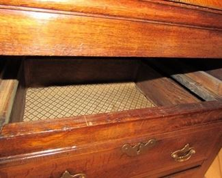 """Offered at $7000.  Oak six drawer plus two door North Wales dresser base. Superb example of the classic late 18th century North Wales cupboard dresser base, circa 1790. Excellent top with banded edges. Two rows of four drawers, three top drawers, plus two cupboard doors in the center with attractive shaped panels. Excellent color and condition, cleaned and waxed. (22""""d x 76.75""""l x 31""""h) ~ Please send inquiries via text to 251.525.0966 and reference the photo number."""