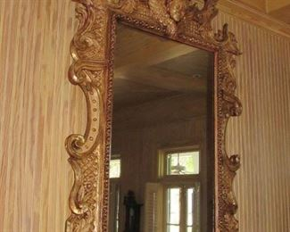 "Offered at $6900.  French gilt carved wood mirror with cherub and ""winds of time"" carvings. Approx. 1790 era. Some slight cracking expected with age of piece, and easily repairable. (84"" x 52"") ~ Please send inquiries via text to 251.525.0966 and reference the photo number."