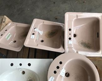 Mocha and white sinks in cast iron, porcelain, and ceramic