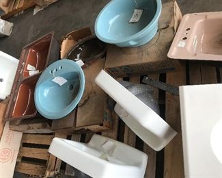 Vintage copper brown kitchen sinks and regency blue sinks. White cast iron sinks.