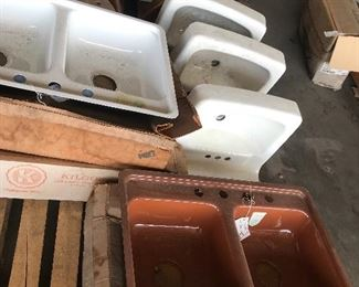 Vintage copper brown kitchen sinks, white, and regency blue sinks.