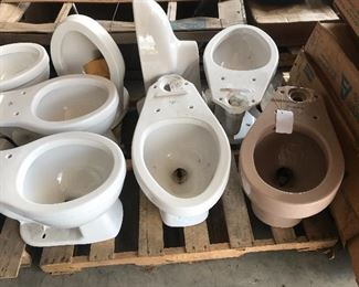 White, off white, and a mocha toilet available