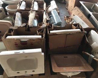 Many many vintage American Standard porcelain china sinks in white, beige, blue, and more