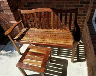 Restored bench and table.  Sanded and finished with Minwax  protectant stain.    $250