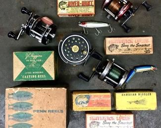 Vintage fishing lure boxes and reels