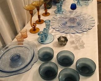 Colored glassware.  Footed cake stand, Cambridge Caprice fed plate, Fostoria Baroque corset (center bowl and candles), carnival glass