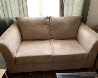 This love seat is in excellent condition, it looks just like the couch but the picture makes it look stained.