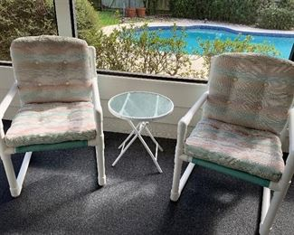 There are 4 of these chairs and 2 tables