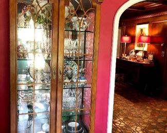 There Are Two Matching Lighted Curio Cabinets...