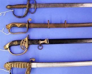Swords: (Top to Bottom) 1920s Spanish Rapier, Japanese WWI Dress, ENglish Dress, English Naval