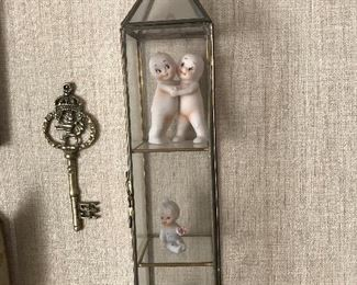 Glass curio  wall cabinet with kewpie dolls