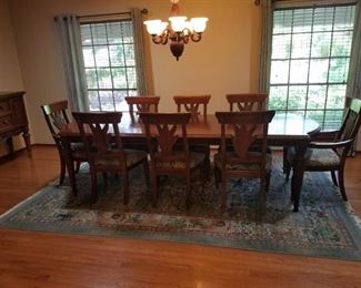 Thomasville Ernest Hemingway Dining Table, 8 chairs and matching buffet table. Rug is also available.