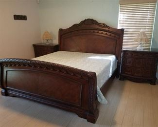 King size sleigh bed (mattress not included) with 2 matching night stands, dresser, chest and bench. Not all pieces shown in picture. See other pictures to view those pieces! ALL MATCHING.  Night stands have marble tops!
